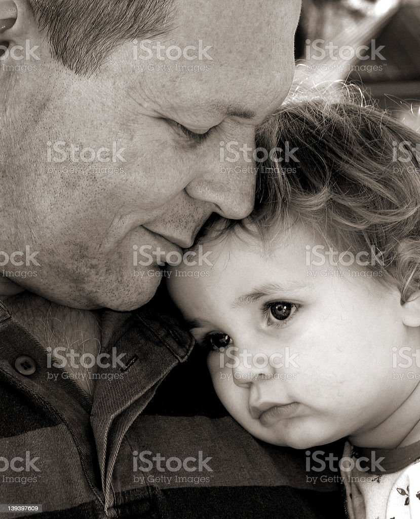 Black and white portrait of a dad hugging his child royalty-free stock photo