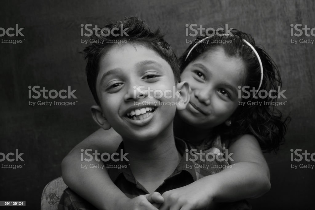 Black and white portrait of a Happy Boy and girl stock photo