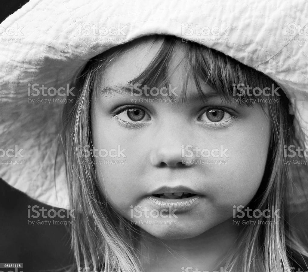 Black and white portrait of a little girl in hat royalty-free stock photo