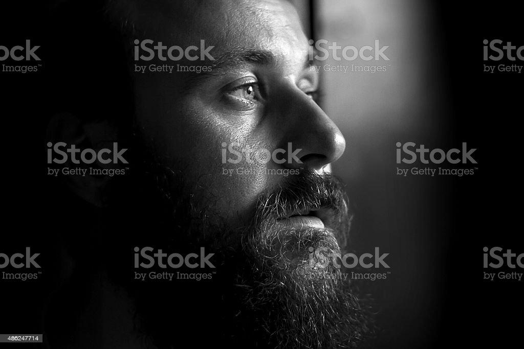 Black and white portrait of a serious man, side view bildbanksfoto