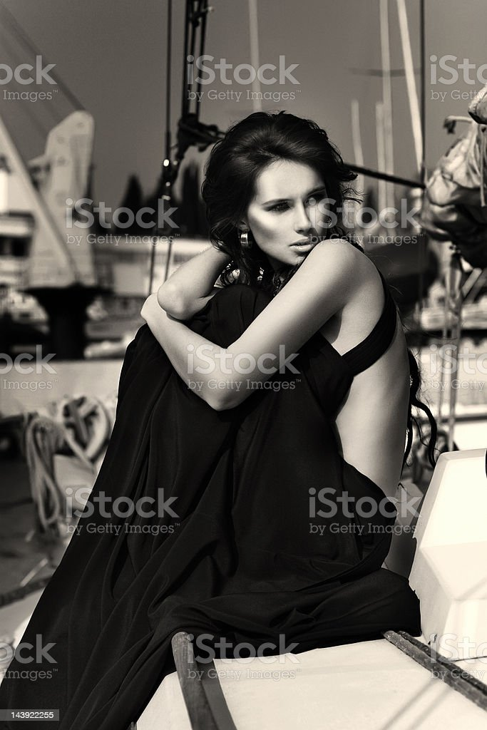 Black and white portrait of beautiful woman at the yacht stock photo