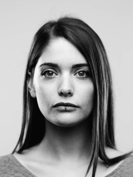 Black and white portrait of confident real young woman stock photo