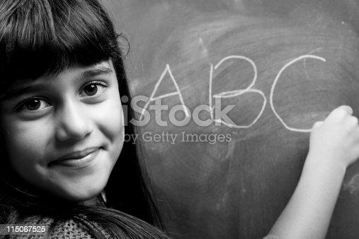Black And White Portrait Of Little Girl Learning Alphabet