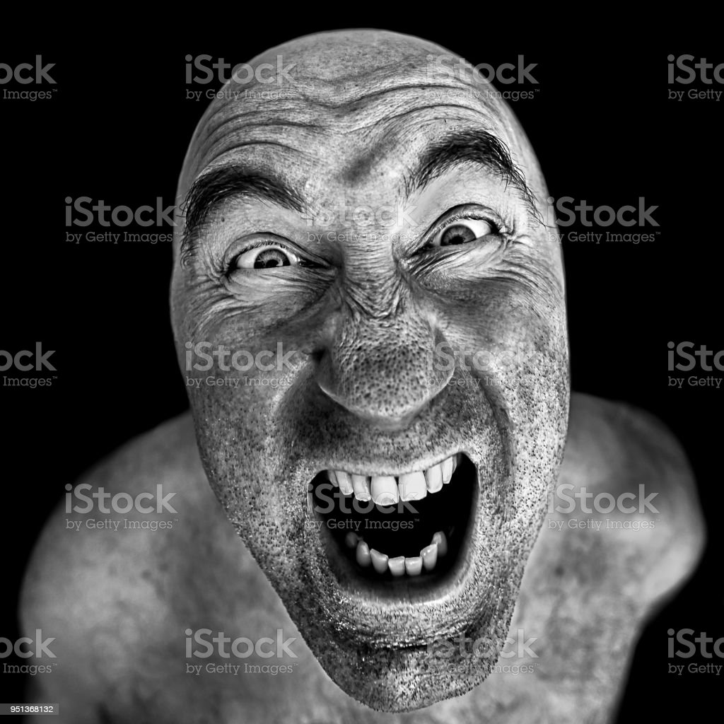 Black and white portrait of mad man stock photo