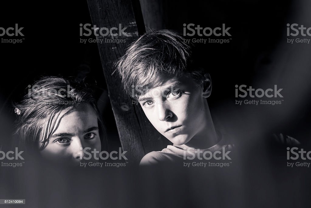 black and white portrait of two teenagers stock photo
