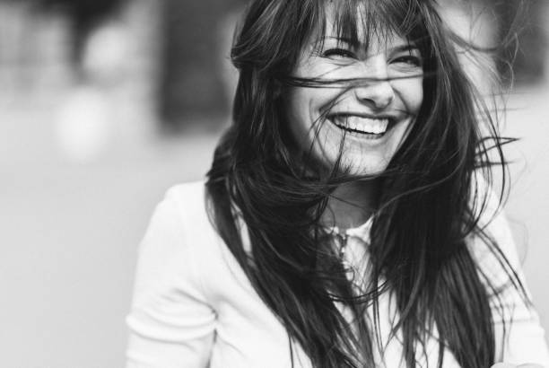 Black and white portrait of woman with messy hair stock photo