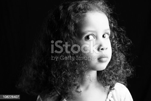 Black and white portrait of serious young girl.