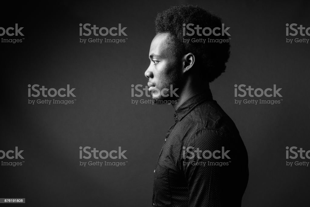 Black And White Portrait Of Young Handsome African Man stock photo