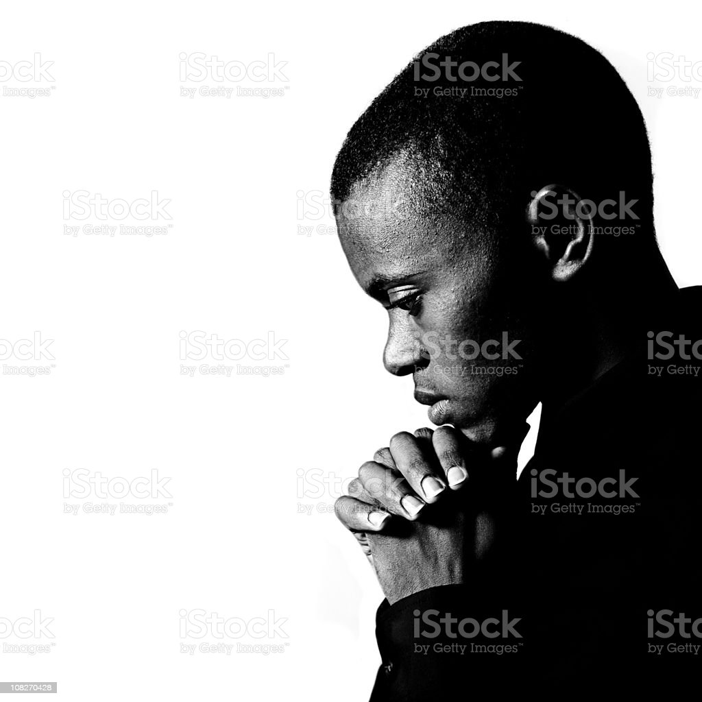 Black and white portrait of young man praying stock photo