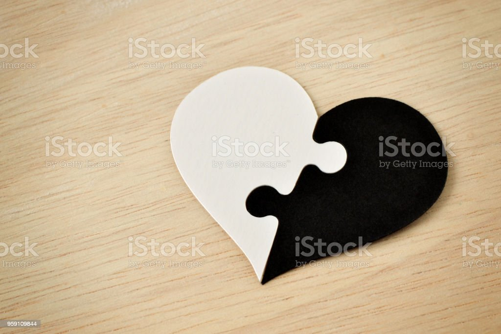 Black and white puzzle heart - Anti-racism concept stock photo