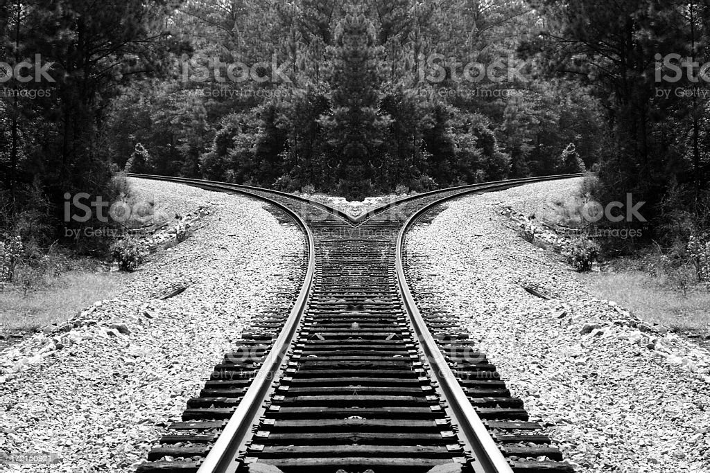 Black and white railroad trick splitting in two directions stock photo