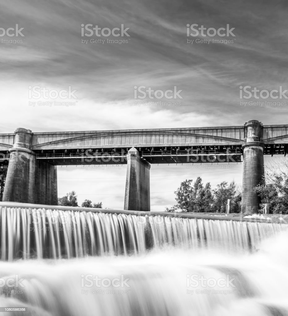 Black and white railway bridge in the background of a waterfall (Neutral Density), NSW, Australia stock photo
