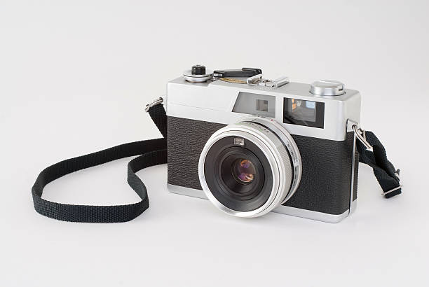 Black and white rangefinder camera on a white surface Image of an