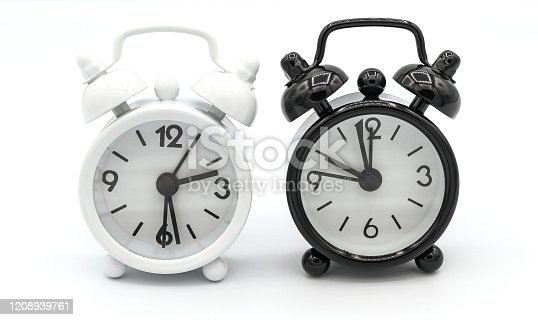 1183352589 istock photo Black and White retro alarm clock isolated on white background. 1208939761