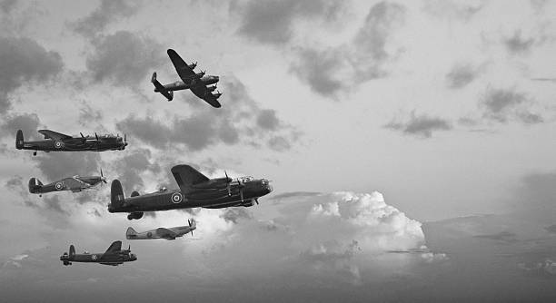 Black and white retro image Battle of Britain WW2 airplanes Black and white retro image of Lancaster bombers from Battle of Britain in World War Two bomber plane stock pictures, royalty-free photos & images