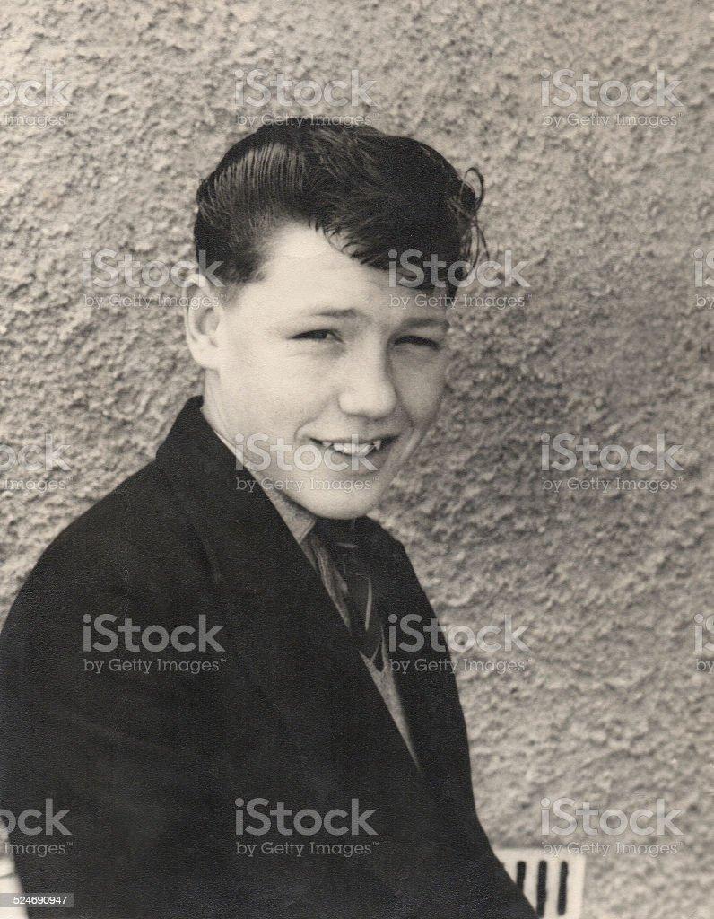 Black and white retro image, handsome 1950s teenage boy, quiff-hairstyle stock photo