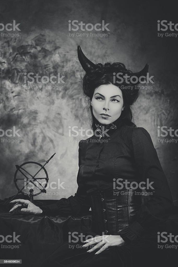 bb7683cc0 Black and white retro photo, woman demon, devil. Girl with - Stock image .