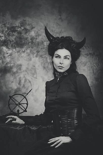black and white retro photo, woman demon, devil. girl with - gothique photos et images de collection