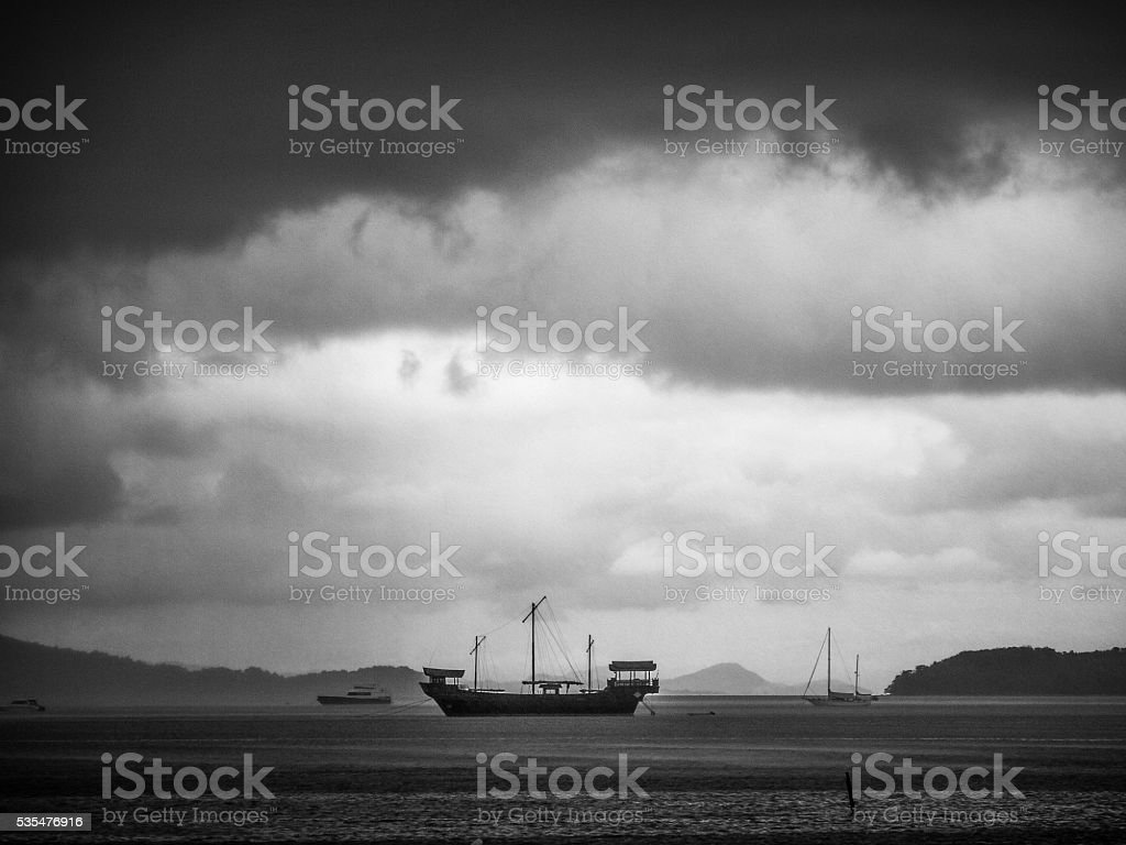 This old fashioned sail ship is moored off the coast of Koh Lanta,...