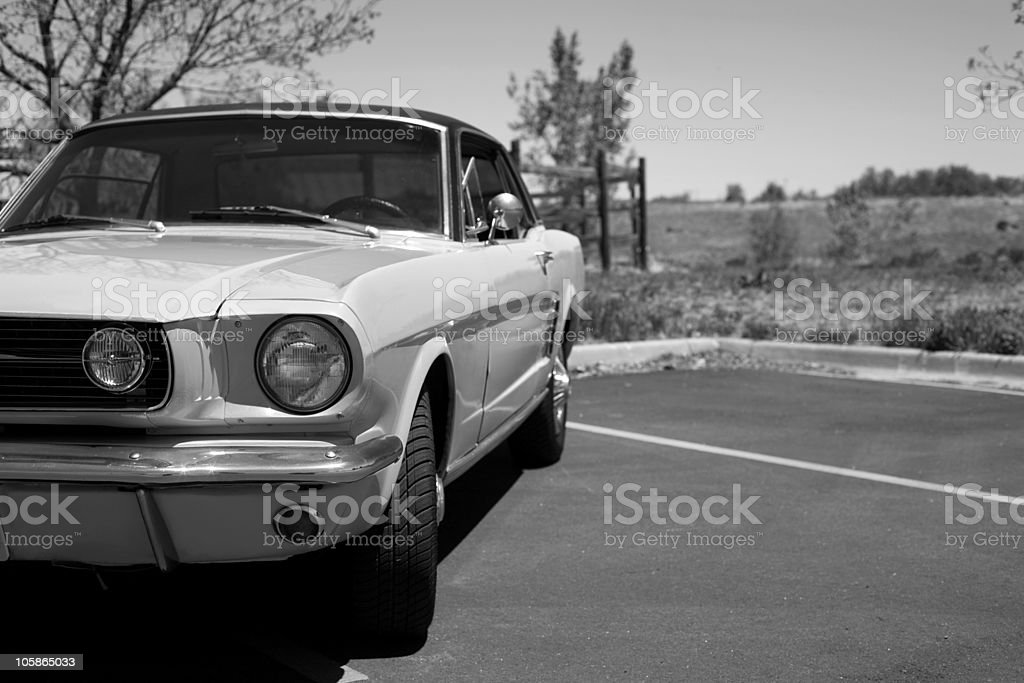 A black and white shot of a classic car  stock photo