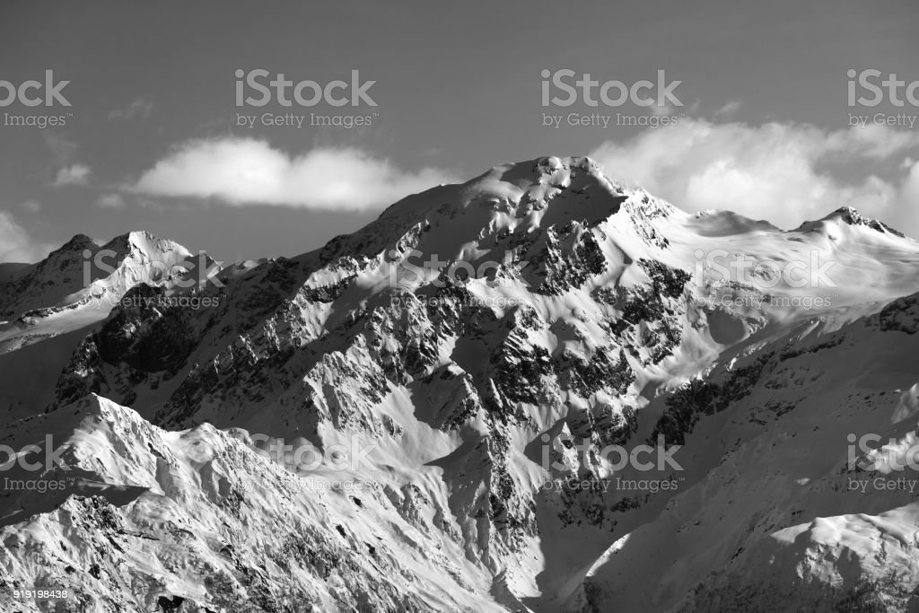 Black and white snow winter mountains at nice sun evening stock photo