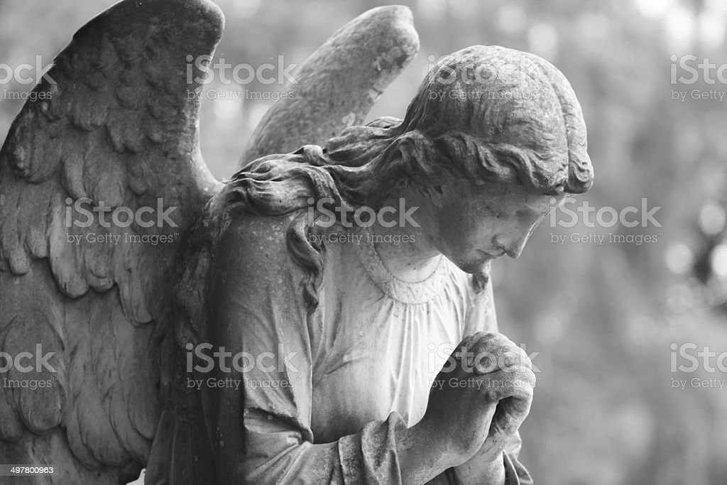Black and white stone angel stock photo