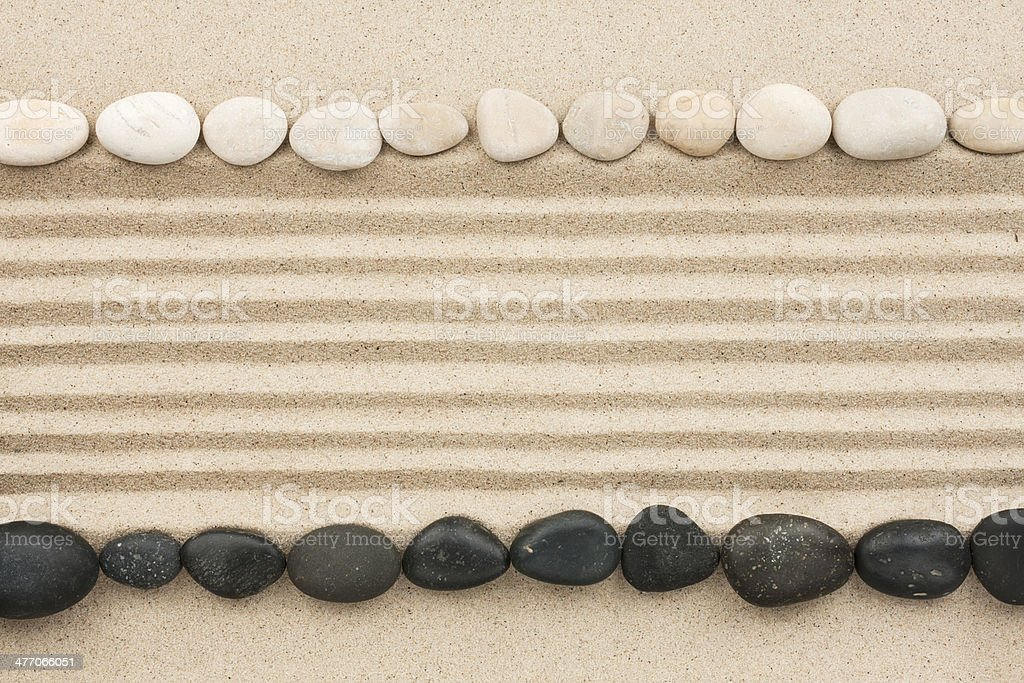 Black and white stones on sand royalty-free stock photo