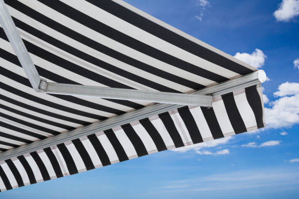 black and white striped awning isolate on white background stock photo