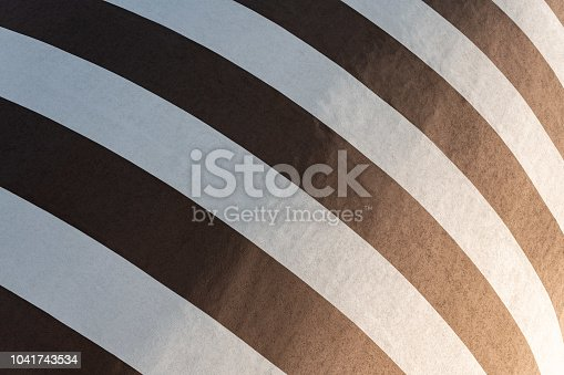 639291528istockphoto Black and white striped building painting. Modern wall design 1041743534