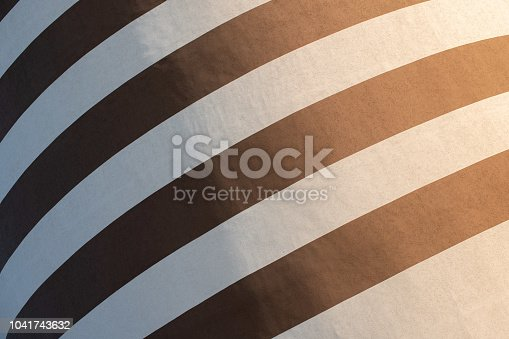 639291528istockphoto Black and white striped building painting. Modern wall design 1041743632
