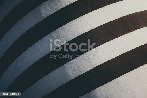 639291528istockphoto Black and white striped building painting. Modern wall design 1041743660