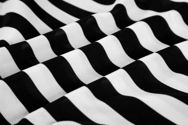 Black and white stripes on rippled fabric stock photo