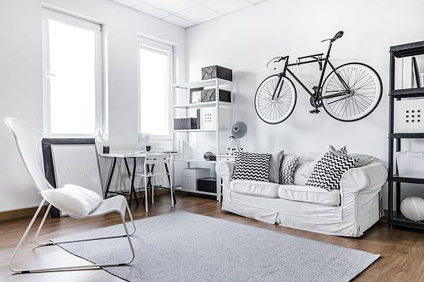 Black and white studio room Black and white studio room of young hipster bachelor stock pictures, royalty-free photos & images