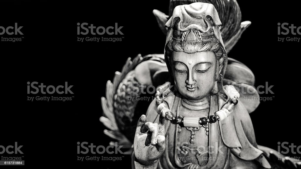 Black and white style of Buddha statue with light dark stock photo