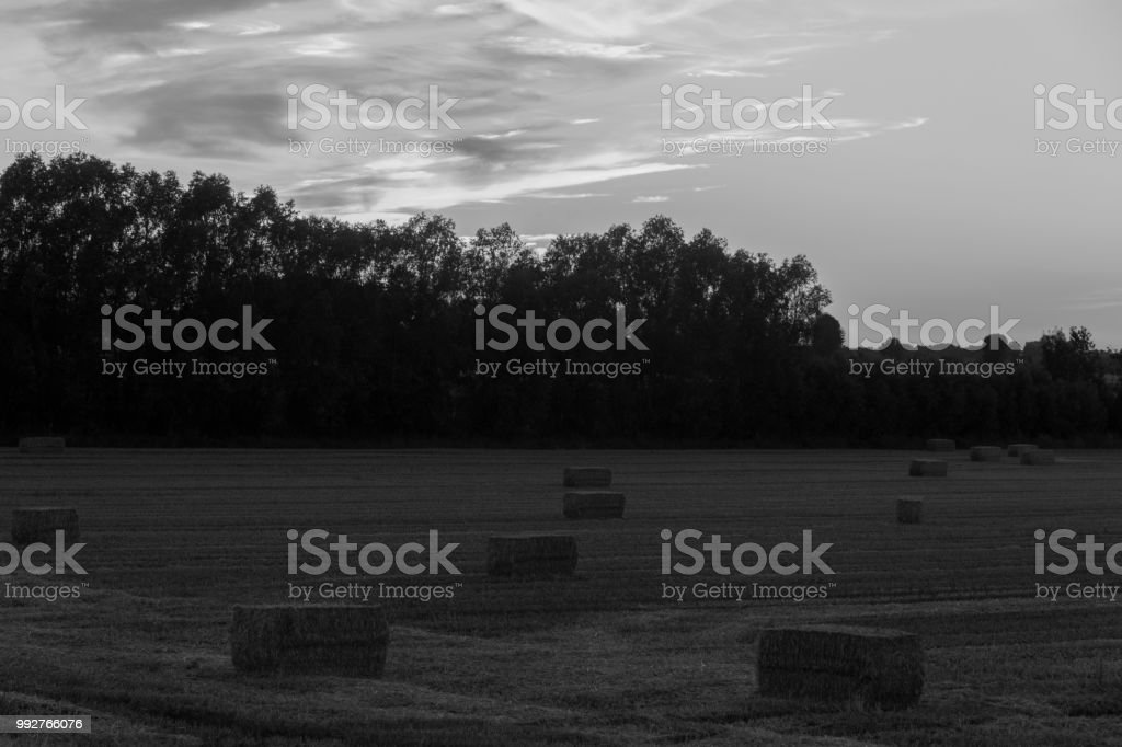 sundown dusk sunset vibrant sky rolling hills countryside rural...