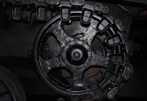 Noir et blanc réservoir caterpillar roue côté visionner photo. - Photo