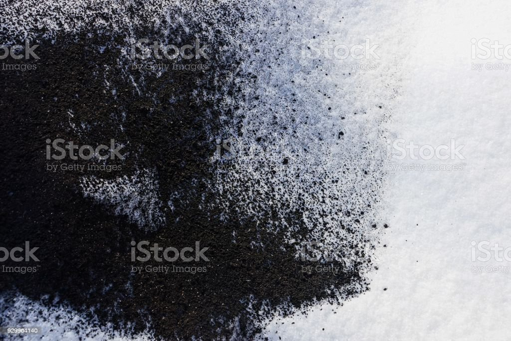 black and white texture from the ashes of a fire and snow stock photo
