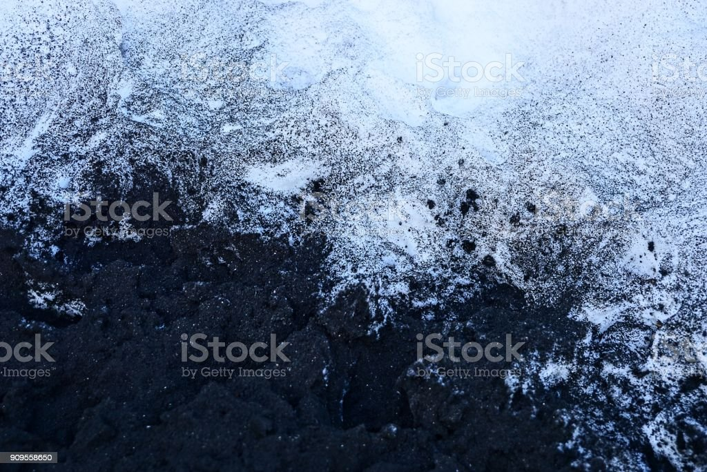 black and white texture of ash and snow stock photo