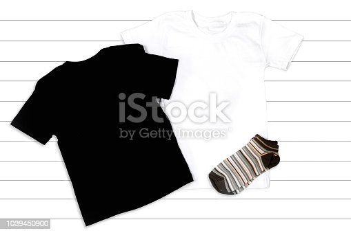 Black and White T-shirts Mockup - Flat Lay on a White Wooden Background