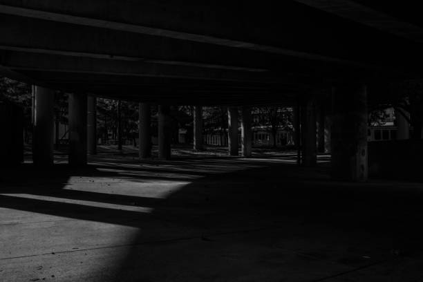 Black and White Under Highway stock photo