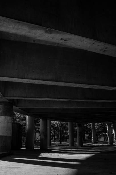 Black and White Underneath Highway stock photo