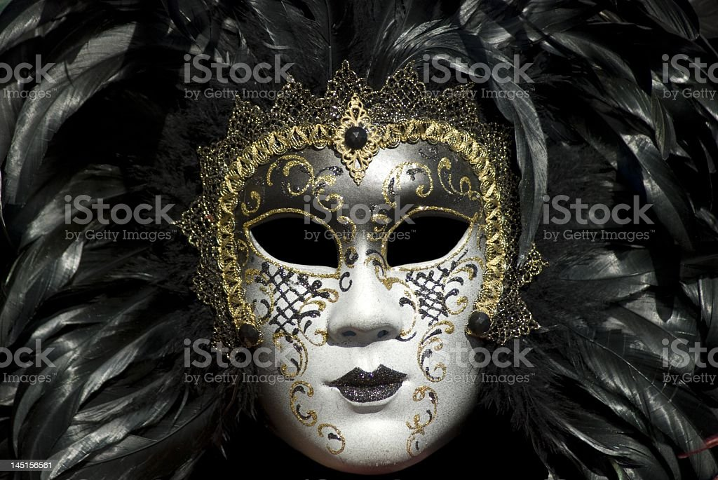 Black and white venetian mask with feather headdress stock photo