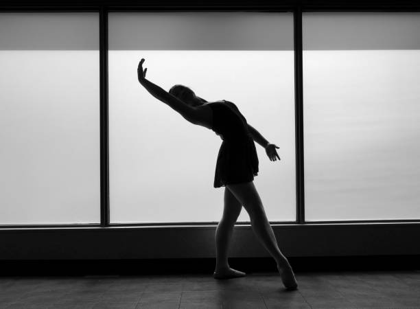 Black and white version of Ballet Dancer Backbend Silhouette stock photo