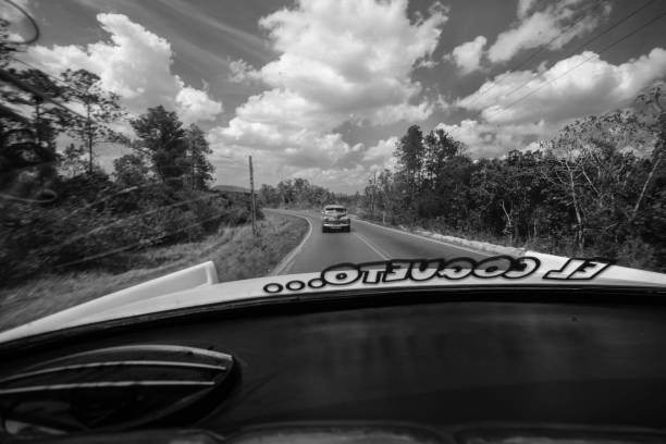 Black and White View from rear view of car interior of classic car on Cuban roads stock photo