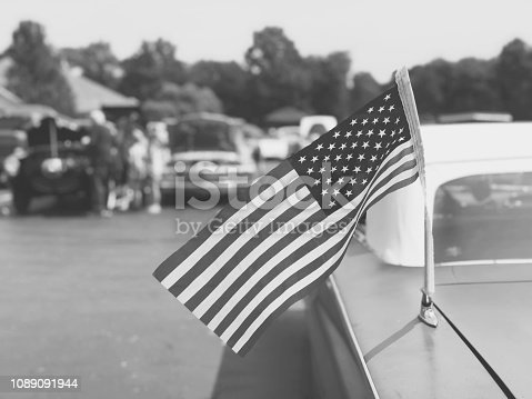 Vintage American Flag on Old Classic Car at Cruise In Car Show, Black and White Retro Style
