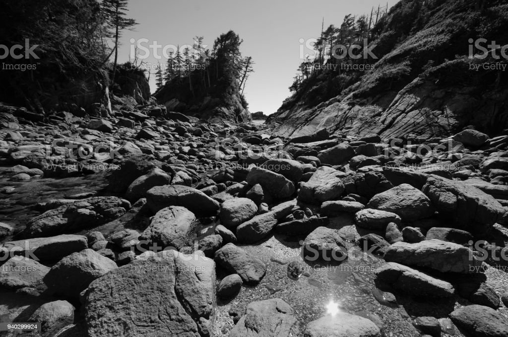 Wide angle view of boulders and rocks between islands at low tide in...