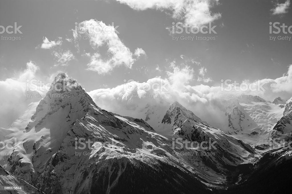 Black and white winter mountains with clouds stock photo