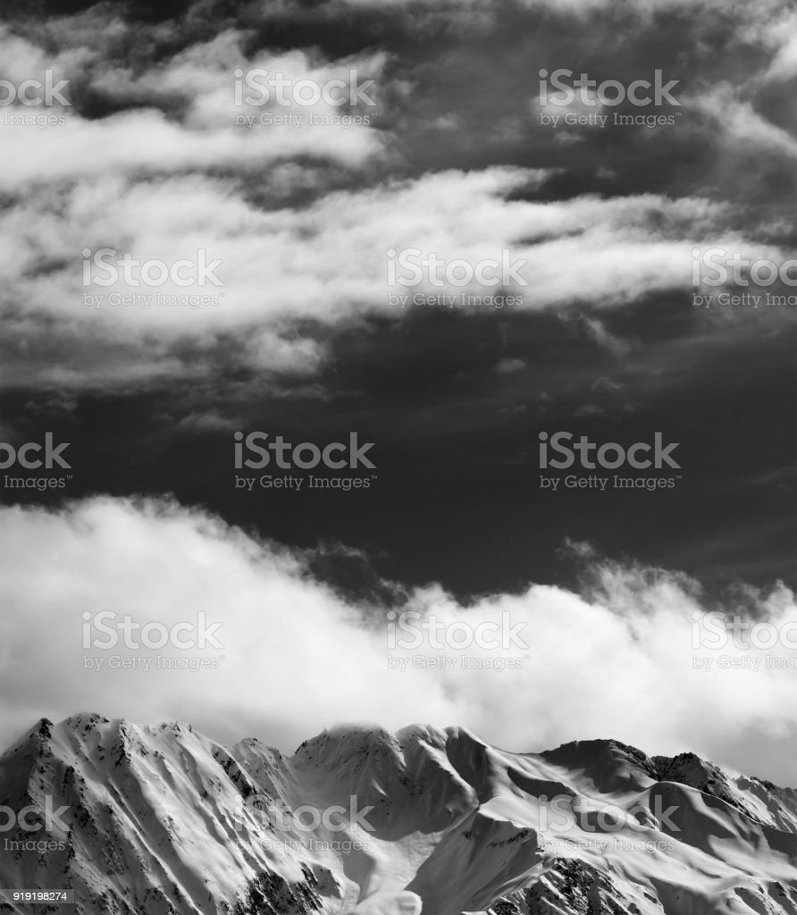 Black and white winter snow mountains at nice sun evening stock photo