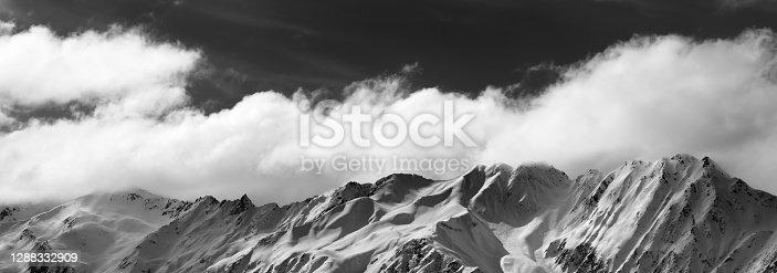 Panoramic view on black and white winter snowy mountains at nice sunny day. Caucasus Mountains. Georgia, region Svaneti.