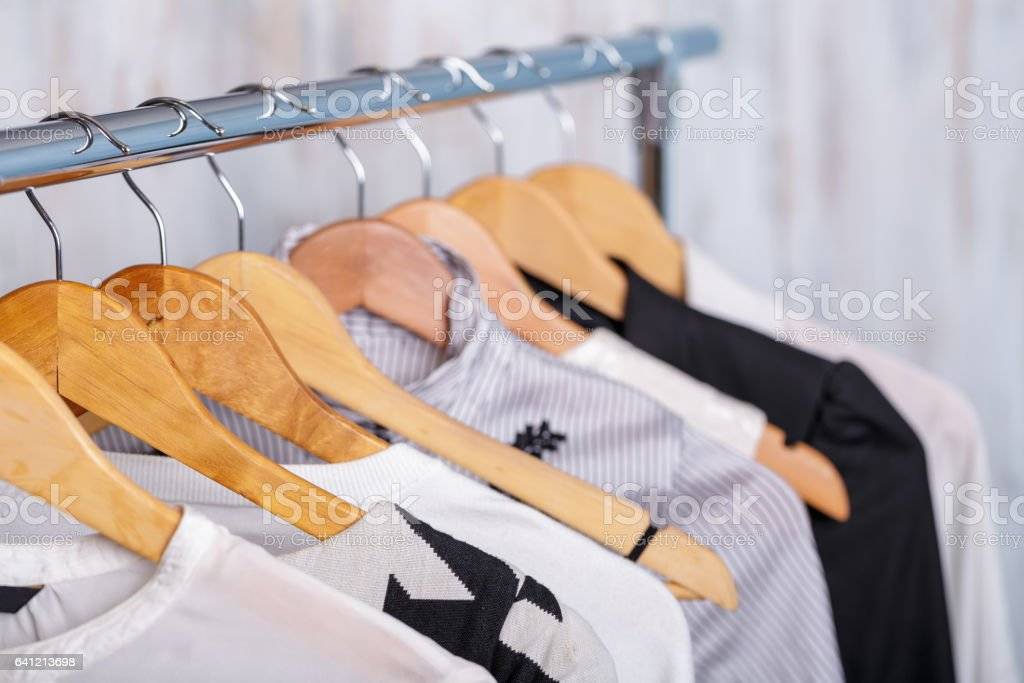 black and white womens clothes on hangers on rack in fashion sto - foto stock